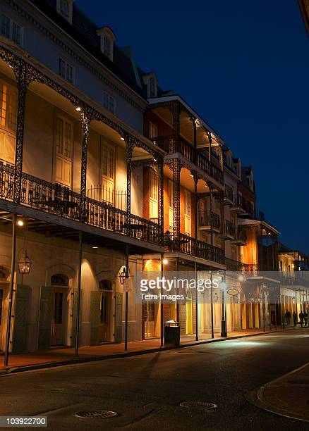french quarter of new orleans at night - new orleans stock photos and pictures
