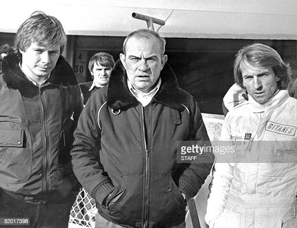 French racing car manufacturer Guy Ligier poses between his two Formula 1 pilots Didier Pironi and Jacques Laffite 11 January 1980 who will drive a...