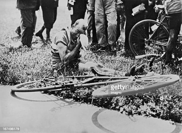 French racing cyclist and winner of the Tour de France in 1930 and 1932 André Leducq breaks together after the final sprint of the third stage of the...