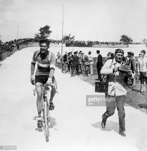 French racing cyclist Charles Pelissier jellow jersey and winner of the 1st stage ParisCaen of the 24th Tour de France arrives in Caen on July 2 1930