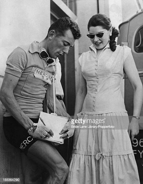 French racing cyclist Rene Privat signs an autograph for a fan in Rouen before the start of the 4th stage of the Tour de France 1st July 1957