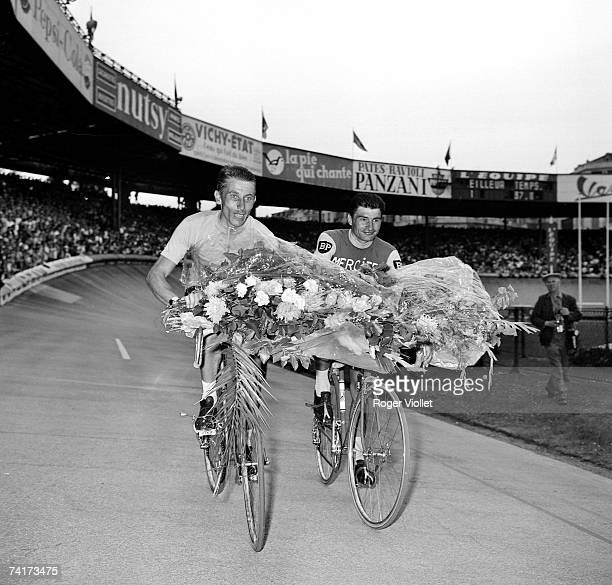 French racing cyclists Jacques Anquetil left and Raymond Poulidor respectively 1st and 2nd of the 1964 Tour de France during their lap of honour at...
