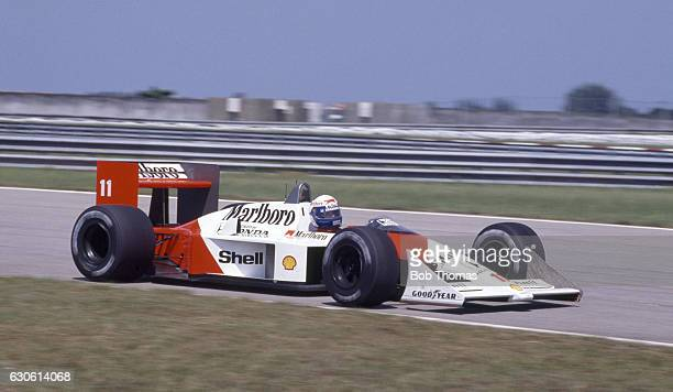French racing driver Alain Prost drives the Honda Marlboro McLaren McLaren MP4/4 to finish in first place to win the 1988 Brazilian Grand Prix in Rio...