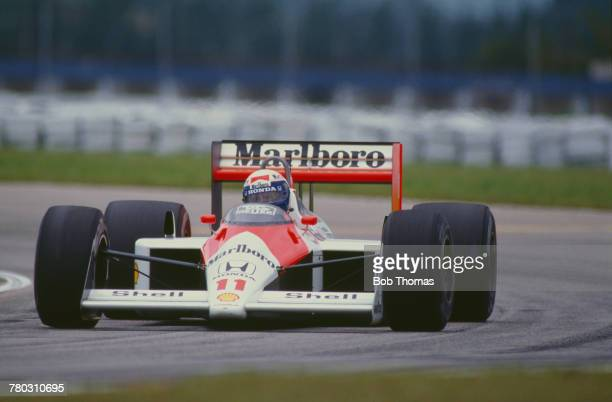 French racing driver Alain Prost drives the Honda Marlboro McLaren McLaren MP4/4 Honda V6 turbo to finish in first place to win the 1988 Brazilian...