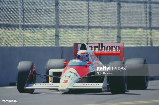 French racing driver Alain Prost drives the Honda Marlboro McLaren McLaren MP4/5 Honda V10 to finish in first place to win the 1989 United States...