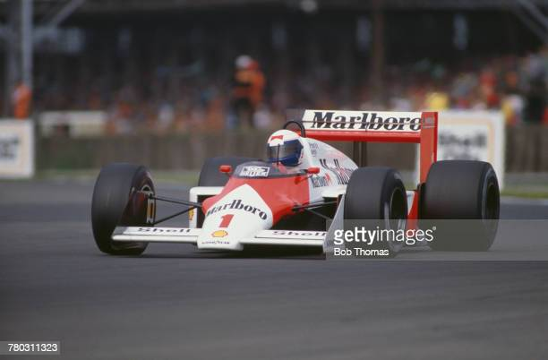 French racing driver Alain Prost drives the Marlboro McLaren International McLaren MP4/3 TAG/Porsche V6t in the 1987 British Grand Prix at...