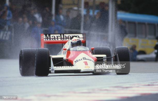 French racing driver Alain Prost drives the Marlboro McLaren International McLaren MP4/3 TAG/Porsche V6t to finish in first place to win the 1987...