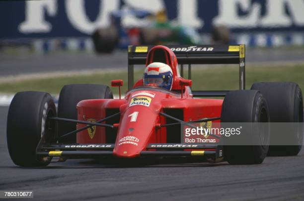 French racing driver Alain Prost drives the Scuderia Ferrari Ferrari 641/2 to finish in first place to win the 1990 British Grand Prix at Silverstone...