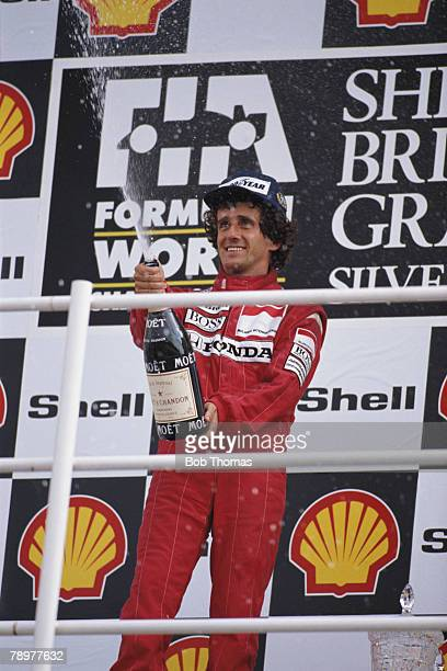 French racing driver Alain Prost pictured spraying a bottle of champagne on the podium after driving the Honda Marlboro McLaren McLaren MP4/5 Honda...