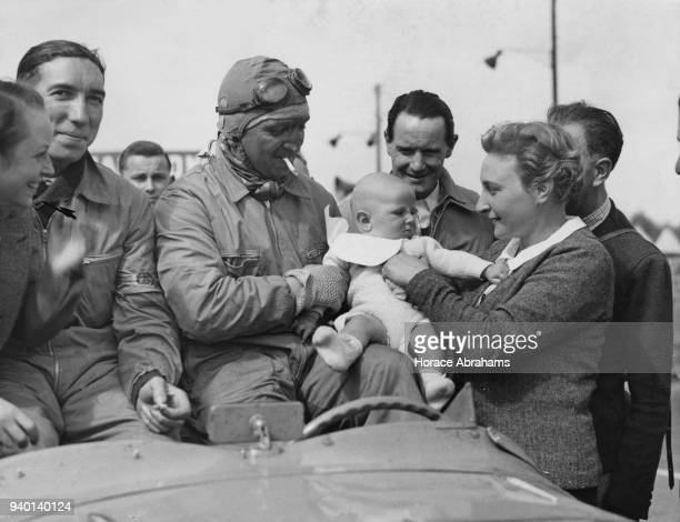 French racing driver Charles de Cortanze with his wife and baby after coming fifth in the 24 Hours of Le Mans France 20th June 1938