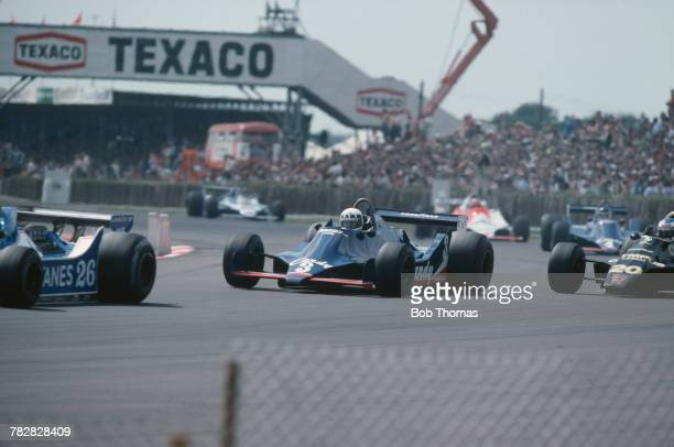 French racing driver Didier Pironi pictured in centre driving the Candy Tyrrell Team Tyrrell 009 Cosworth V8 to finish in 10th place in the 1979...