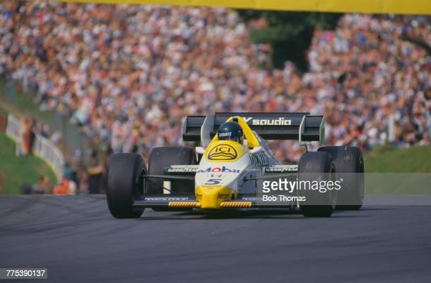 French racing driver Jacques Laffite drives the Saudia Williams Honda Williams FW09B Honda RA164E 15 V6t in the 1984 British Grand Prix at Brands...