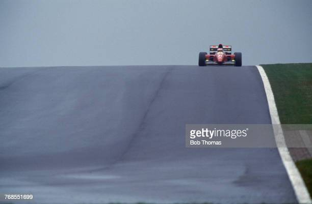 French racing driver Jean Alesi drives the Scuderia Ferrari Ferrari F93A Ferrari V12 in the 1993 European Grand Prix at Donington Park Circuit in...