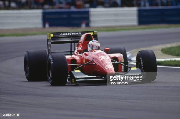 French racing driver Jean Alesi drives the Scuderia Ferrari SpA Ferrari F92A Ferrari 038 35 V12 in the 1992 British Grand Prix at Silverstone Circuit...