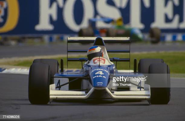 French racing driver Jean Alesi drives the Tyrrell Racing Organisation Tyrrell 019 Cosworth V8 to finish in 8th place in the 1990 British Grand Prix...