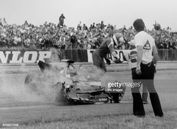 French racing driver JeanPierre Beltoise jumps for safety from his wrecked STP March 731 Auto after crashing on the first lap The race was stopped...