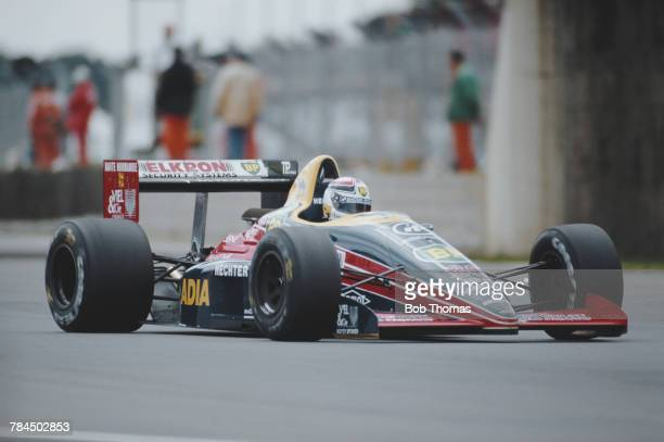 French racing driver Philippe Alliot drives the Larrousse Calmels Lola LC88 Cosworth V8 to finish in 14th place in the 1988 British Grand Prix at...