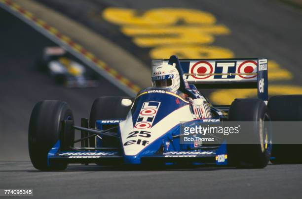 French racing driver Rene Arnoux drives the Equipe Ligier Ligier JS27 Renault EF4B 1.5 V6t to finish in 4th place in the 1986 British Grand Prix at...
