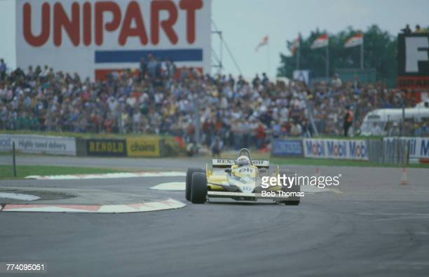 French racing driver Rene Arnoux drives the Equipe Renault Elf Renault RE30 RenaultGordini EF1 15 V6t through Woodcote chicane to finish in 9th place...