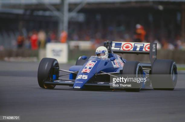 French racing driver Rene Arnoux drives the Ligier Loto Ligier JS29C Megatron M12/13 1.5 L4t in the 1987 British Grand Prix at the Silverstone...