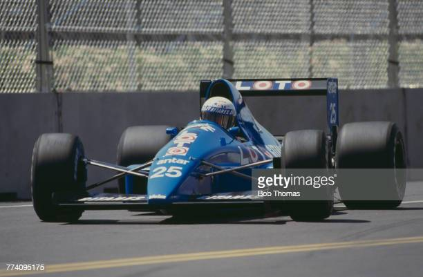 French racing driver Rene Arnoux drives the Ligier Loto Ligier JS33 Ford Cosworth DFR 3.5 V8 in the 1989 United States Grand Prix in Phoenix, Arizona...