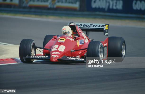 French racing driver Rene Arnoux drives the Scuderia Ferrari SpA SEFAC Ferrari 126C2B Ferrari 021 1.5 V6t to finish in 5th place in the 1983 British...