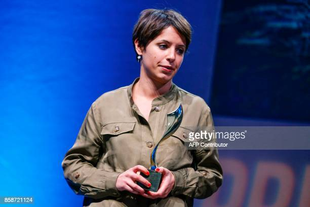 French radio reporter Gwendoline Debono receives the Radio prize award for her work 'L'entrée dans Mossoul' during the closing ceremony of the 2017...