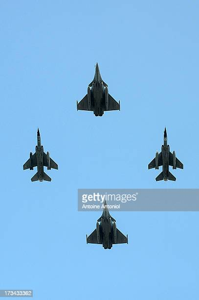 French Rafale aircraft two German typhoon and one Mirage 2000 RDI fly during the Day parade on the Champs Elysees on July 14 2013 in Paris France The...
