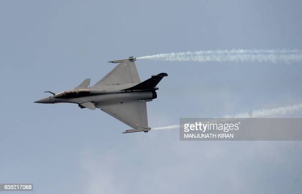 A French Rafale fighter aircraft from Dassault Aviation built for the India Airforce performs manoeuvres during an aerial display over the skies of...