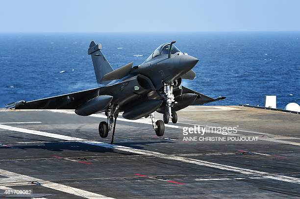 French Rafale fighter aircraft lands on aircraft carrier CharlesdeGaulle at sea off the coast of Toulon southern France on January 15 ahead of the...
