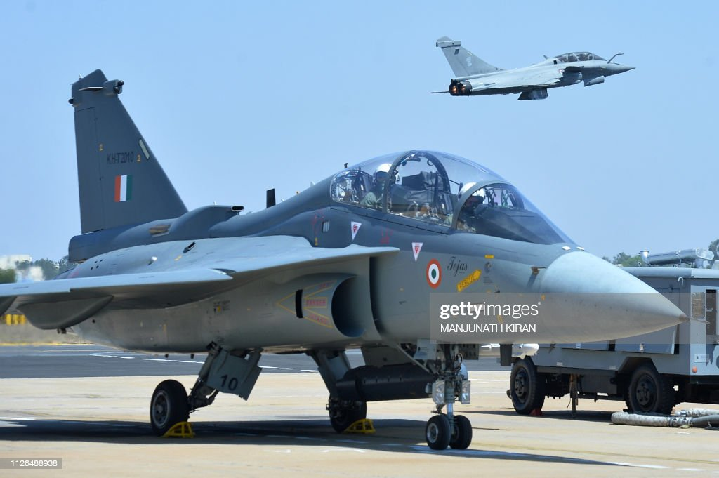 A French Rafale fighter flies over an Indian Airforce Tejas