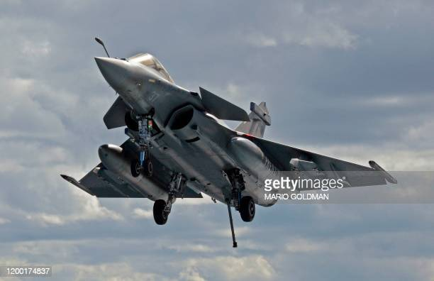 French Rafale fighter jet approach to the French aircraft carrier, Charles de Gaulle, off the eastern coast of Cyprus in the Mediterranean Sea on...