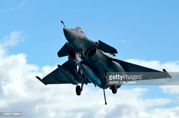 A French Rafale fighter jet approaches to land at the deck in the French aircraft carrier Charles de Gaulle off the eastern coast of Cyprus in the...