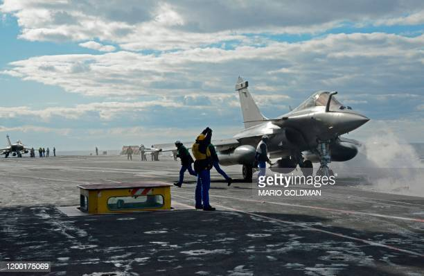 French Rafale fighter jet is catapulted from the French aircraft carrier, Charles de Gaulle, off the eastern coast of Cyprus in the Mediterranean Sea...