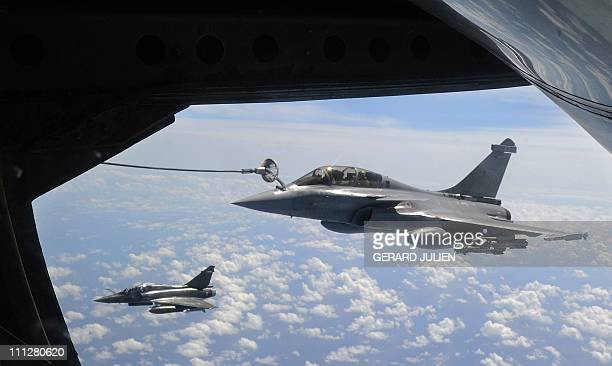 French Rafale fighter jet refuels with an airborne Boeing C135 on March 30 2011 during a refuelling operation above the Mediterranean sea as part of...