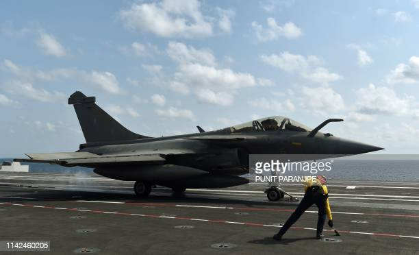 A French Rafale fighter jet takes off from the aircraft carrier Charles de Gaulle during a joint IndoFrench naval exercise Varuna in the Arabian sea...