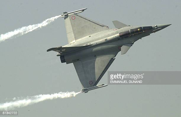 French Rafale fighter plane performs rolls 13 October during a press preview of Seoul Air Show 2001 The Rafale is one of the leading contender in a...