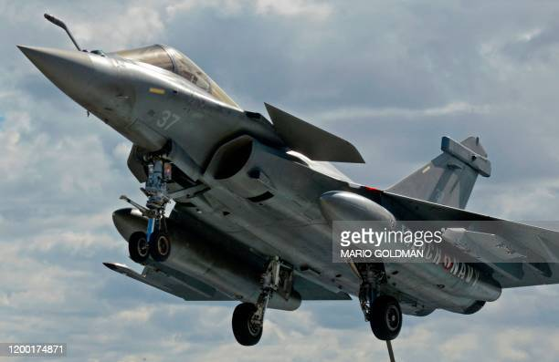 A French Rafale fighterer jet approach to the French aircraft carrier Charles de Gaulle off the eastern coast of Cyprus in the Mediterranean Sea on...