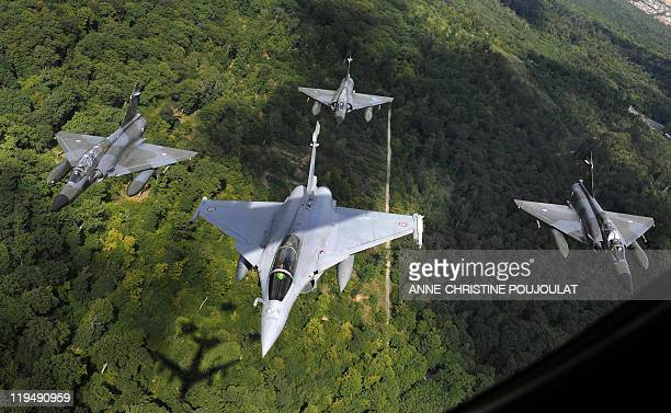 A French Rafale jet flanked by three Mirage 2000N flies next to Paris on July 14 2011 during the Bastille Day military parade AFP PHOTO /...