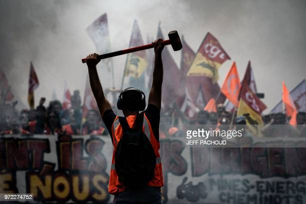 French railway workers demonstrate on June 12 2018 on the streets of the city of Lyon on the 15th day of rolling train strikes which began in April...