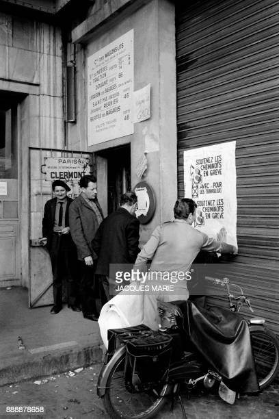French railway workers on strike stick posters of the picket line in May 1968 at the Gare de Lyon train station in Paris during the MayJune 1968...