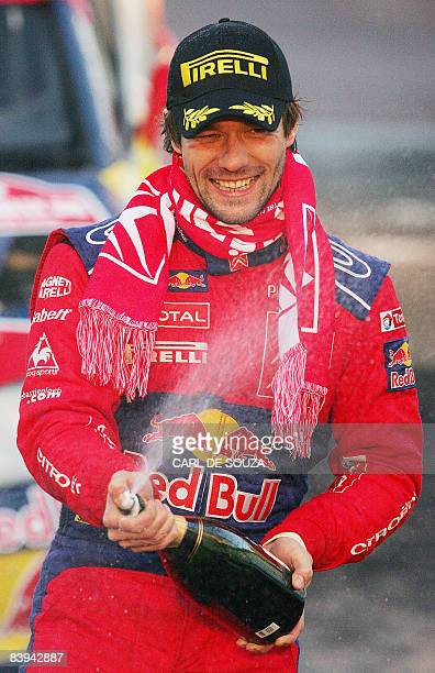 French rally driver Sebastien Loeb of the Citroen Total WRT rally team celebrates after winning the World Rally Championships and the Wales Rally GB...