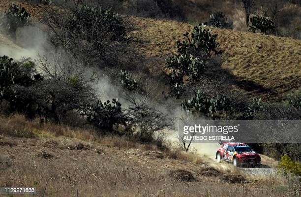 French rally driver Sebastien Ogier and codriver Julien Ingrassia of Citroen Total WRT compete during the first stage of the FIA World Rally...