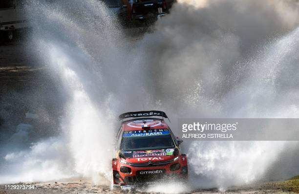 TOPSHOT French rally driver Sebastien Ogier and codriver Julien Ingrassia of Citroen Total WRT compete during the first stage of the FIA World Rally...