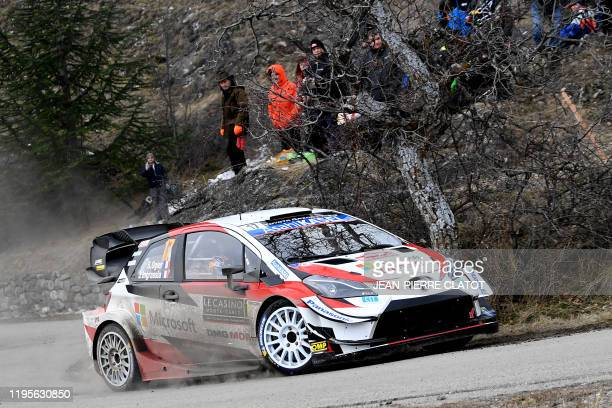 French rally driver Sebastien Ogier and his codriver Julien Ingrassia steer their Toyota Yaris WRC on January 24 during the SS4 SaintClement...