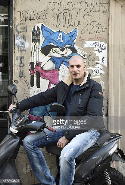 French rap singer Akhenaton of the group IAM which is celebrating its 20 years together poses on October 14 2014 in Paris IAM is releasing a new a...