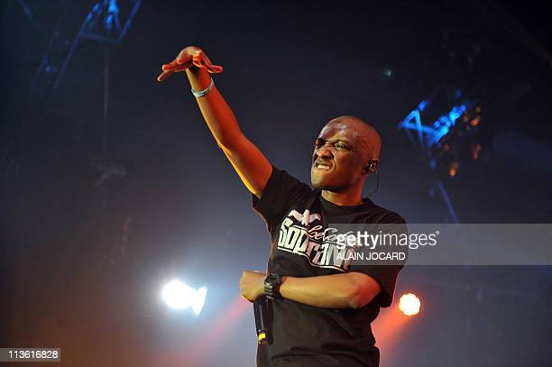 """French rap singer """"Soprano"""" gestures to the audience as he performs on April 21 in Bourges , during the 35th edition of """"Le Printemps de Bourges""""..."""