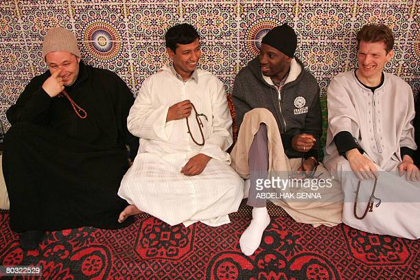 French rapper Abdel Malik member of the brotherhood since his conversion to Islam sits with unidentified converted Christians during a visit to the...