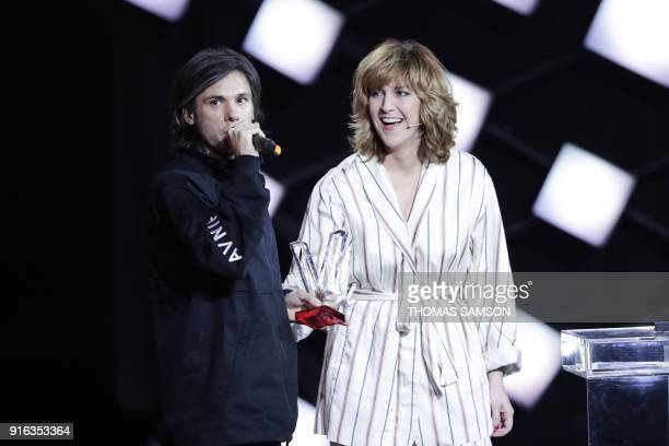 French rapper Aurelien Cotentin aka Orelsan celebrates after after receiving the best male artist award during the 33rd Victoires de la Musique the...