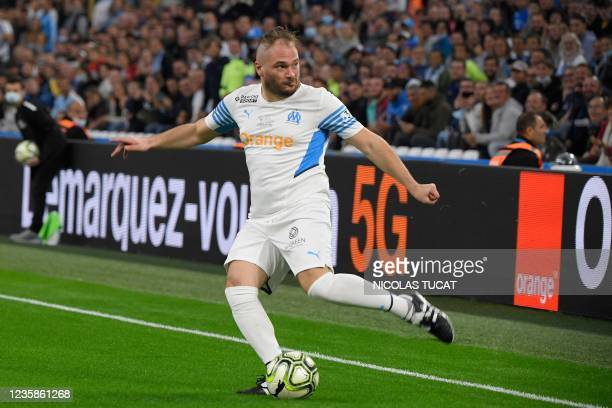 """French rapper Jul plays with the ball during the charity """"Heroes"""" football match between former Olympique de Marseille's players and Team Unicef, at..."""